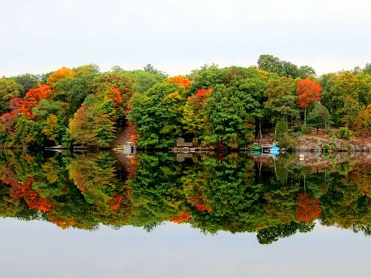 The shores of Upper Greenwood Lake display the type of fall foliage that makes the Highlands a hiking destination each autumn.