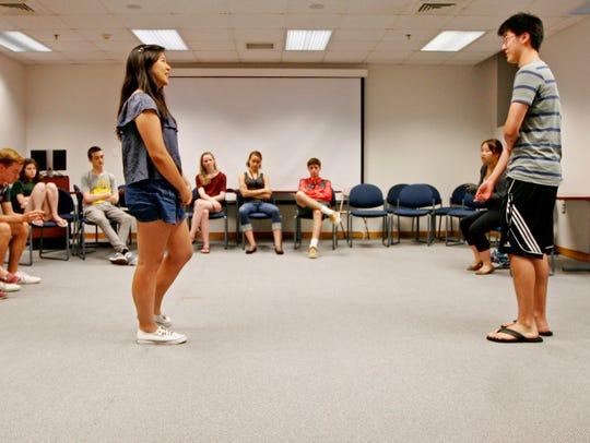 Students Serena Hsu and Christopher Gao interact as