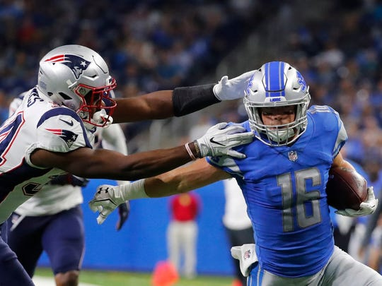 Lions receiver Jace Billingsley tries to evade Patriots defensive back David Jones in the second half Aug. 25, 2017 in Detroit.