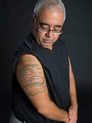 Survivor Brian Branco's tattoos honor those who died