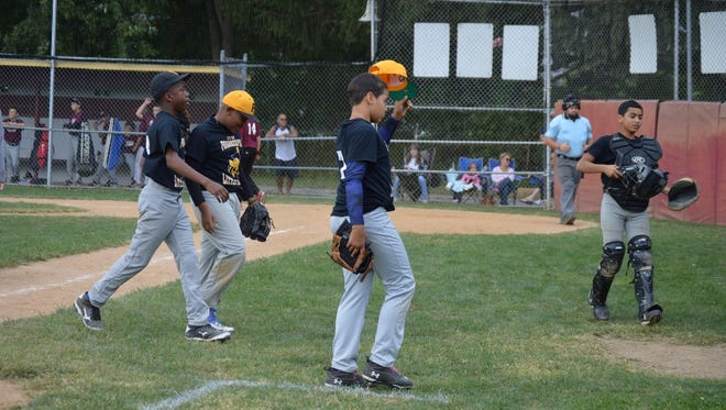From left to right, Jayvion Smith, Scott Ennish, Ali Harrell and Mateo Brown walk off the field during a City of Poughkeepsie Little League in the Majors division in 2014.