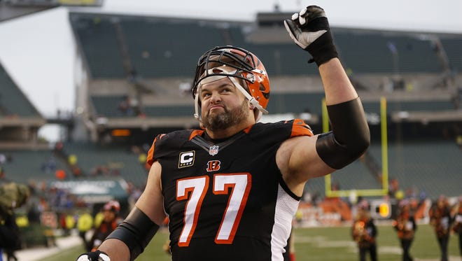 Cincinnati Bengals tackle Andrew Whitworth (77) celebrate after their 42-28 win against the Indianapolis Colts at Paul Brown Stadium.