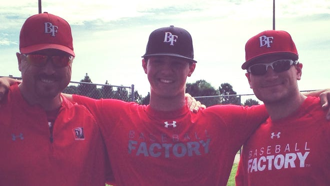 Mountain Heritage senior Gray McCurry, middle, has committed to play baseball for Catawba Valley Community College.