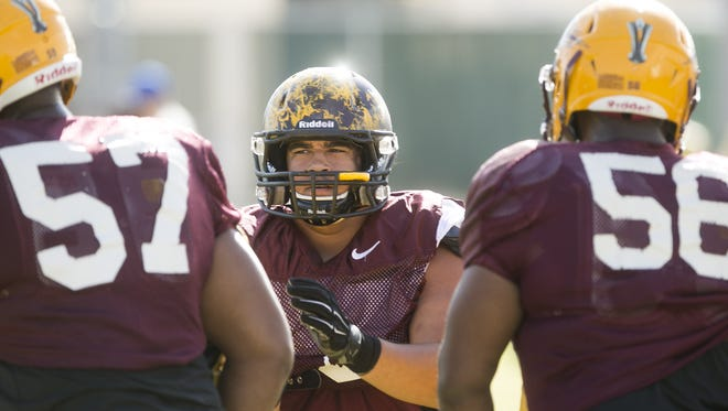 ASU offensive lineman Nick Kelly (center) during an ASU Spring football practice in Tempe on Tuesday, April 7, 2015.