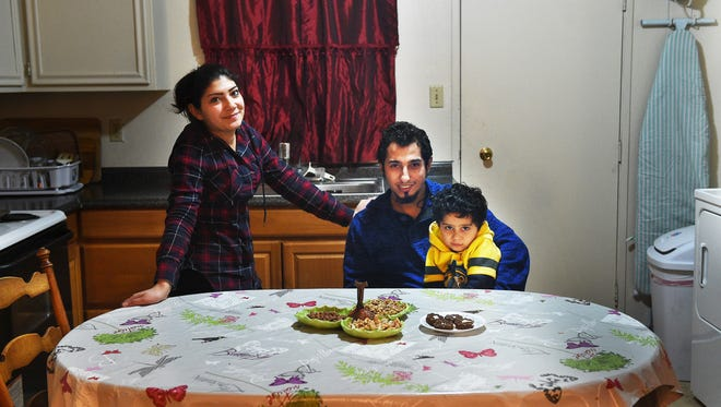 Syrian refugees Zakaria Mustafa, his wife Nibhar Sheikmous and their 4-year-old son Rahjad pose for a portrait in their apartment in Reno on Feb. 1, 2017.