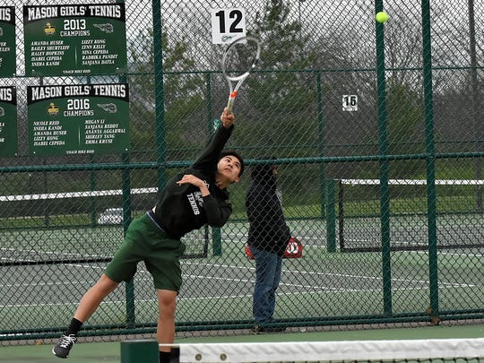 Mason's Diego Cepeda delivers a serve on the way to