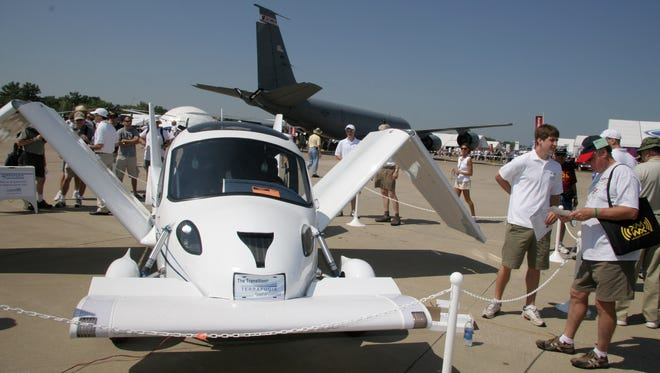 """A Terrafugia """"Transition"""" flying car on display at an airshow in Oshkosh, Wisconsin."""