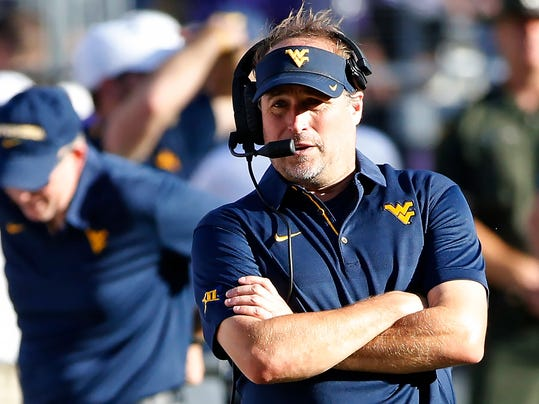 West Virginia head coach Dana Holgorsen walks the sideline during the second half of an NCAA college football game against TCU, Saturday, Oct. 7, 2017, in Fort Worth, Texas. (AP Photo/Ron Jenkins)