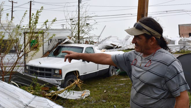Joseph Scirto inspects his trailer and truck, which were badly damaged in Aransas Pass when the town's water tower toppled under the winds of Hurricane Harvey. With the water tower destroyed, officials say it could be weeks before water and electricity re-started.