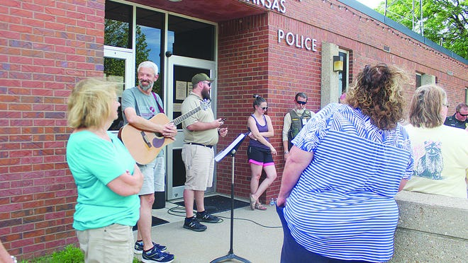 Pratt pastors Mike Neifert (Pratt Friends Church), with guitar, and Dan Chrismer (Ascension Lutheran), middle, led a prayer support service for Pratt city and county police forces, and all emergency workers on the front lines during uncertain times. The Thursday evening event was organized by Donna Rawlings with the Bread of Life organization.