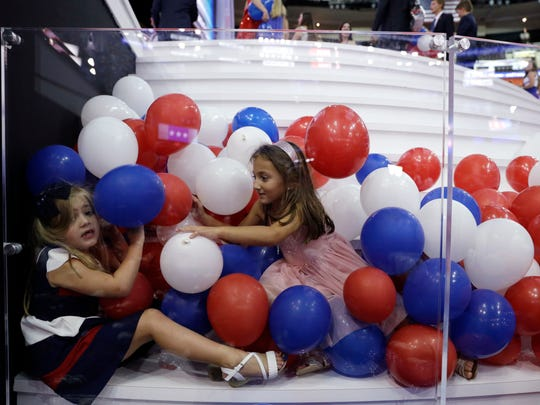 Daughter of the Republican National Committee chairman Reince Priebus,  Grace Priebus, 6, left, and Evangelia Safakis, 5, play in the balloons by the stage after the Republican National Convention in Cleveland Thursday.