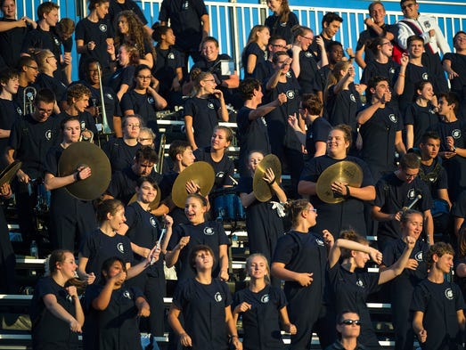 Trojan's Marching band fills the stands and plays through