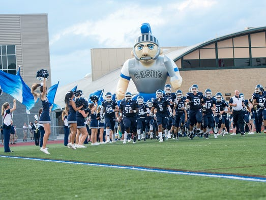 The Trojans charge the field on Friday, Sept. 9, 2016
