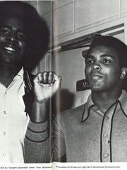 Muhammad Ali stands next to Evangel basketball center