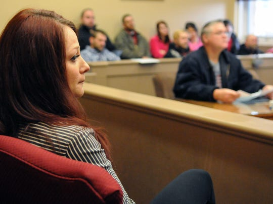 Jennifer Barnes, Josh Barnes' sister, looks away from Thomas Miller during Miller's arraignment Dec. 2, 2014, in Fairfield County Municipal Court. Miller is accused of hitting and killing Josh Barnes with his car more than a year ago.