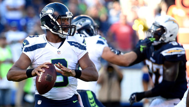 Seattle Seahawks quarterback Russell Wilson prepares to throw against the San Diego Chargers during the first half of a preseason NFL football game Saturday, Aug. 29, 2015, in San Diego.
