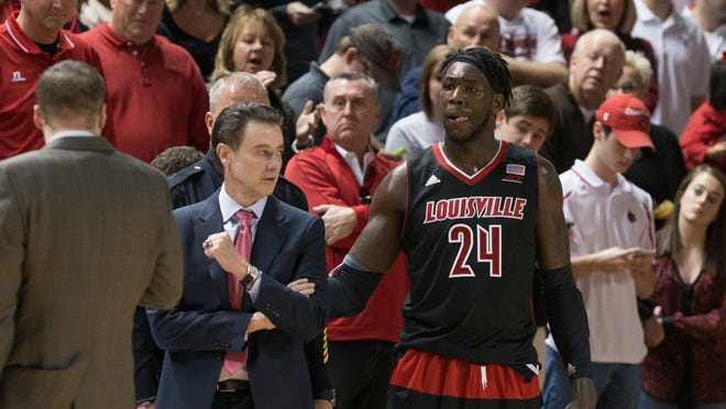 Louisville's head coach Rick Pitino glances over at Montrezl Harrell moments before he was ejected from the game for a fist half brawl. Dec. 20, 2014