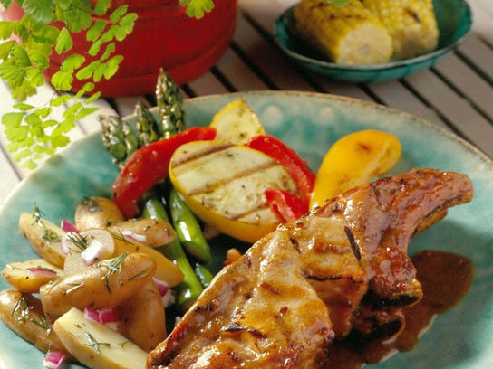Country-style pork ribs are brushed with Asian plum