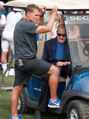 Indianapolis Colts owner Jim Irsay talks with Colts general manager Chris Ballard following the Colts and Ravens joint practice at Grand Park in Westfield on Saturday Aug 18.