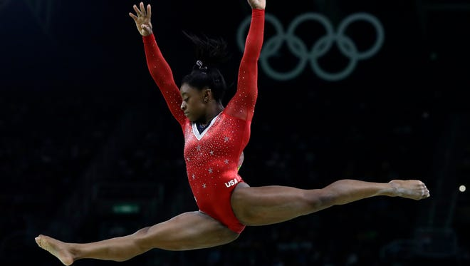 United States' Simone Biles performs on the balance beam during the artistic gymnastics women's apparatus final at the 2016 Summer Olympics in Rio de Janeiro, Brazil, Monday, Aug. 15, 2016.