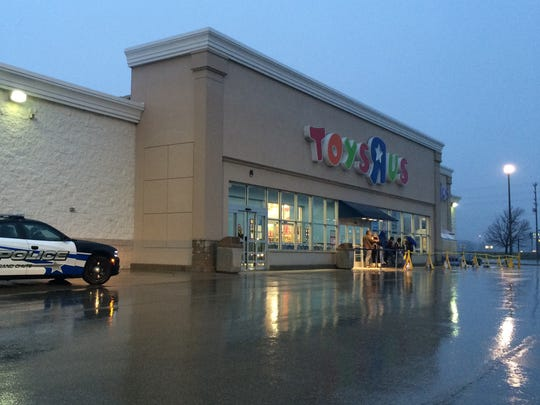 Rain kept many of Toys R Us shoppers in their cars until opening time.