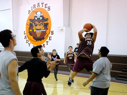 Paint Creek's Frankie Masias (35) puts up a shot during