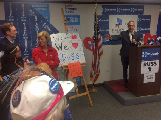 U.S. Senate candidate Russ Feingold, right, speaks to supporters at the Democratic Party of Brown County office in Green Bay on Friday. Congressional candidate Tom Nelson and U.S. Sen. Tammy Baldwin are to the left.