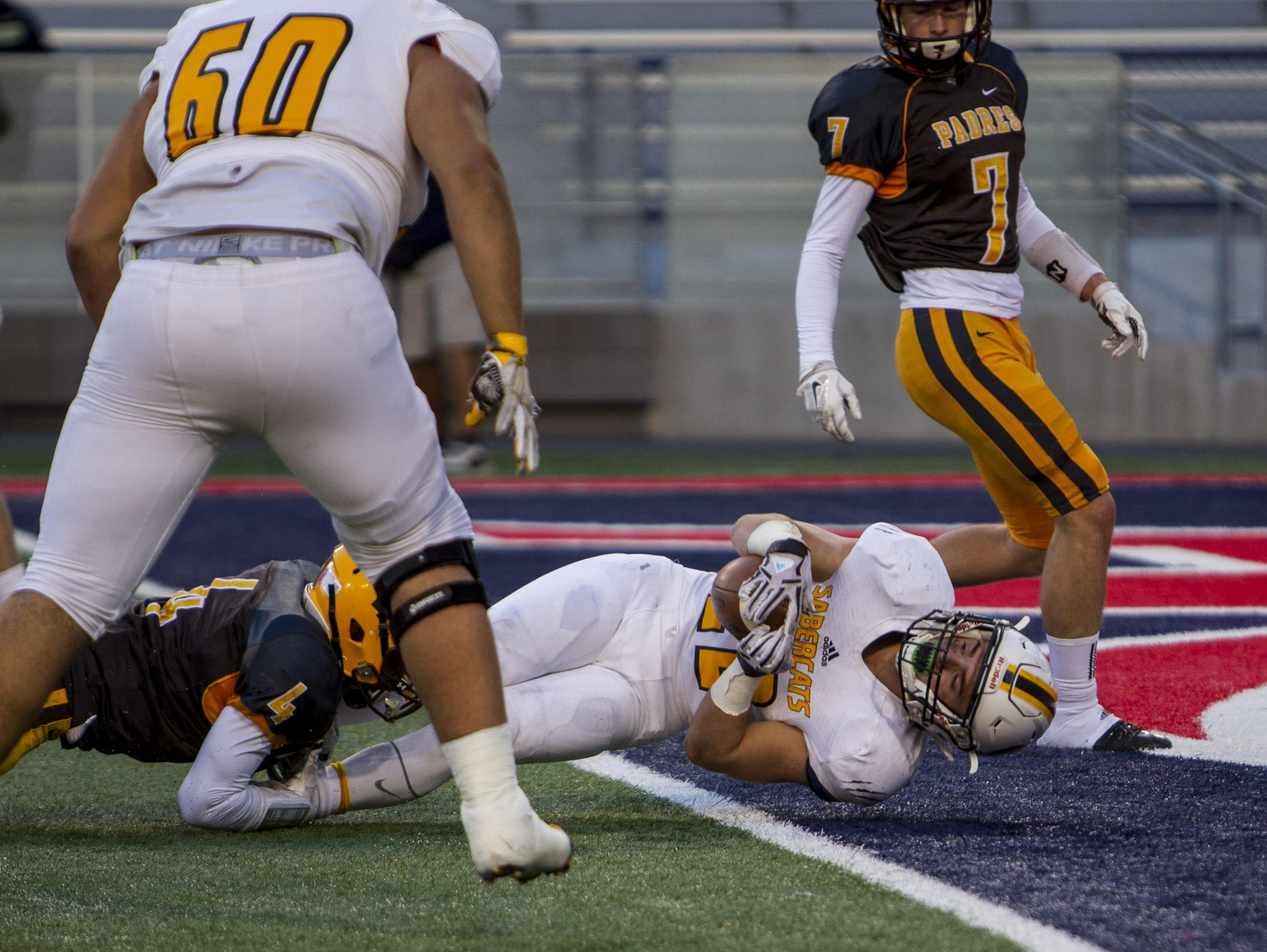 Scottsdale Saguaro's Stone Matthews rushes for a touchdown against Marcos de Niza in the second quarter during the Division II state championship on Saturday, Nov. 28, 2015 at Arizona Stadium in Tucson, Ariz.