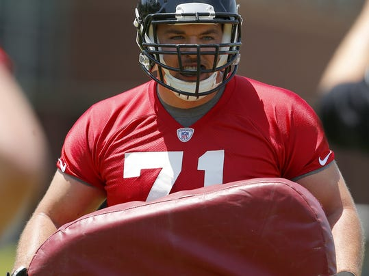 FILE - In this May 7, 2016, file photo, Atlanta Falcons NFL football player Wes Schweitzer (71) takes part of a drill during NFL rookie minicamp football in Flowery Branch, Ga. Normally, the right guard on an offensive line can go through life with hardly any notice. But when you're taking over that spot on the NFL's highest-scoring offense, there's a bit more scrutiny. Wes Schweitzer found that out right away in his debut with the Falcons. (AP Photo/Todd Kirkland, File)