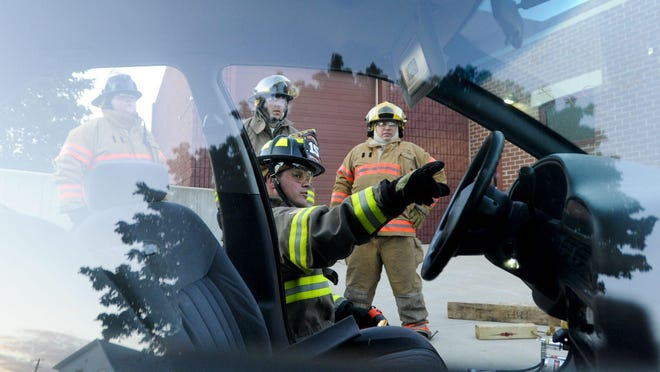 Two Rivers firefighter/paramedic Kris Klein explains vehicle extrication to participants of the Two Rivers Citizen Academy at the Two Rivers Fire Department in 2012.