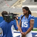 Senior linebaker Josh Forrest is interviewed during the University of Kentucky Football media day at Commonwealth Stadium in Lexington, Ky., on August 7, 2015. Photo by Mike Weaver