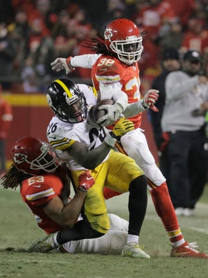 Pittsburgh Steelers running back Le'Veon Bell (26) is tackled by Kansas City Chiefs inside linebacker Ramik Wilson during the second half Sunday. Bell finished with 170 yards rushing.