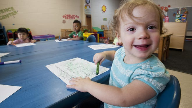 Lillian is all smiles as she colors at the Children's Learning Center at First Baptist Church, a licensed child care center in downtown Montgomery, Ala. on August 5, 2015.