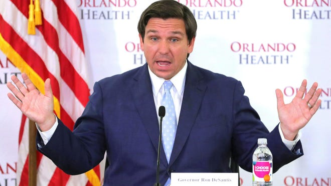 Florida Gov. Ron DeSantis answers a question during a news briefing on the state's status in the coronavirus crisis, at Orlando Health's Orlando Regional Medical Center, Sunday, April 26, 2020.
