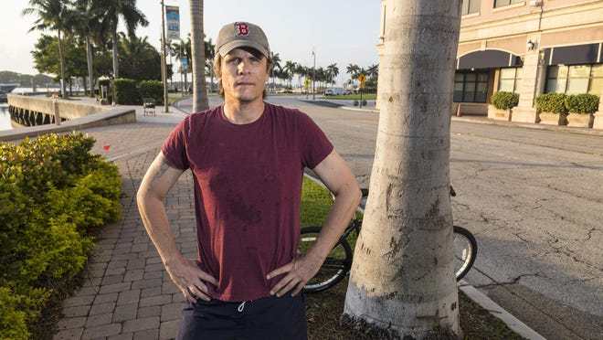 Beau Guyott stands in downtown West Palm Beach on April 15 before starting his walk to Tallahassee to raise awareness of problems with the state unemployment system.