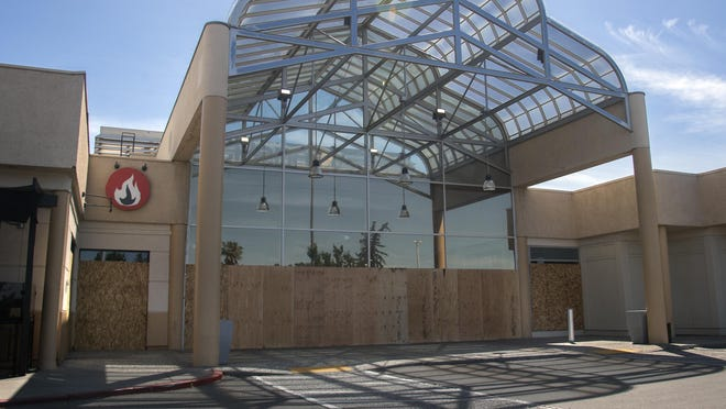 The Weberstown Mall in Stockton is boarded up and remains closed after looters broke windows and stole merchandise on Sunday.