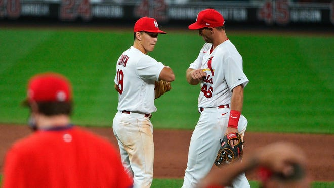 St. Louis Cardinals shortstop Tommy Edman (19) celebrates with first baseman Paul Goldschmidt (46) after the Cardinals defeated the Pittsburgh Pirates on July 24 at Busch Stadium in St. Louis.