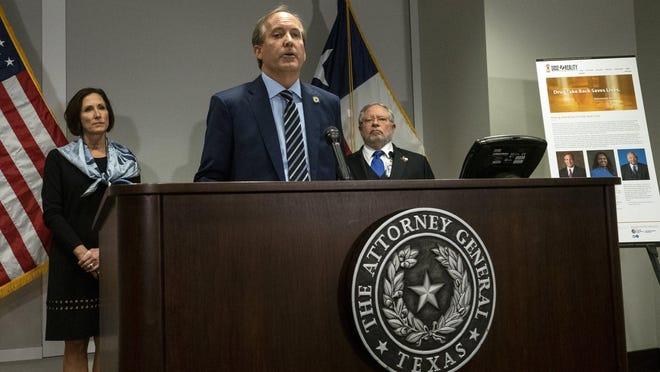 Attorney General Ken Paxton, shown at a press conference last year, is working with his counterparts in other states on an investigation into potentially anti-competitive practices in Google's advertising business.