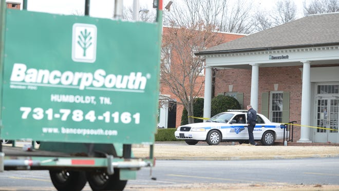 Police blocked off BancorpSouth bank in Humboldt on Wednesday morning after a bank employee was kidnapped and shot. The victim was treated and will be released soon from a Memphis hospital; the accused shooter is in custody, according to officials.