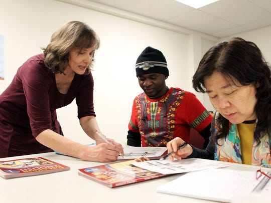 Susan Prepejchal works with 20-year-old Cedrick Buhendwa,