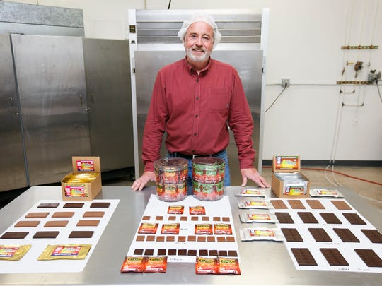 Bill Cyr stands with some of the medicinal and recreational edible cannabis products offered by Gaia Bounty Inc. on Friday, June 24, 2016. The company makes chocolates infused with cannabis oils, including recreational products as well as medical products with THC or CBD, or a balance of the two.