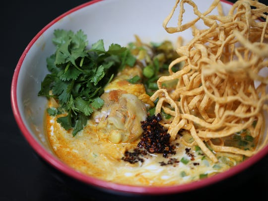 The khao soi kai ($15), a chicken drumstick and noodles