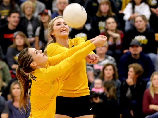 Cascade's Meriah Kindell (3) and Tori Lewis (7) both