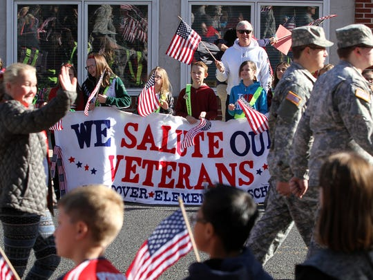 North Dover Elementary School students hold up a sign thanking veterans during the Toms River Veterans Day parade Monday, November 14, 2016.