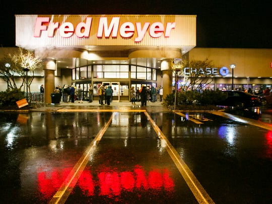 Shoppers line up outside Fred Meyer on Market Street
