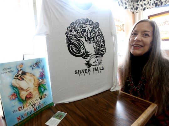 """Allyson Jayne Miller hopes people will enjoy her new book, """"The Cougar, The Wolf, and a Tree Named Albert"""", and her artwork on display at Silver Falls State Park."""