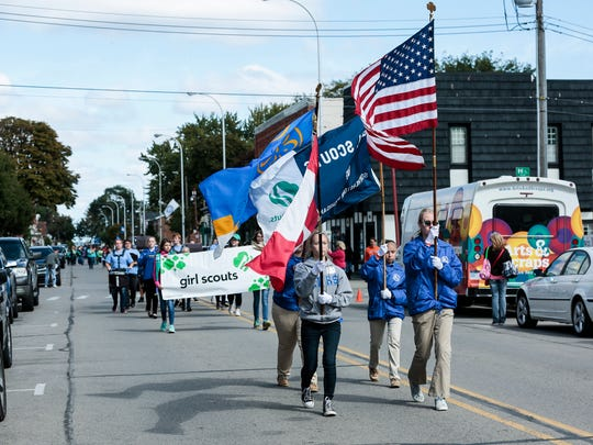 Members of the Girl Scouts march on Water Street in