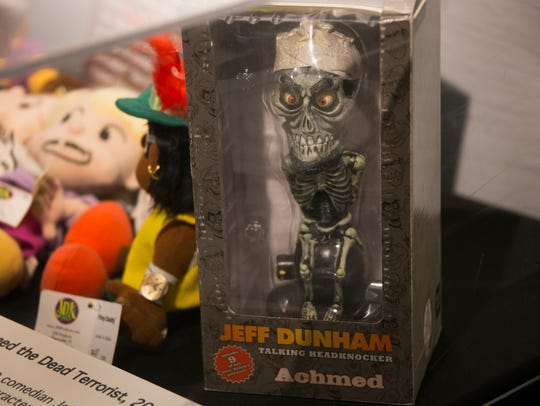 """A replica of Achmed the Dead Terrorist, invented by ventriloquist Jeff Dunham, could be purchased as a toy. This is one of the items in """"Them,"""" an exhibit at the Arab American National Museum in Dearborn."""