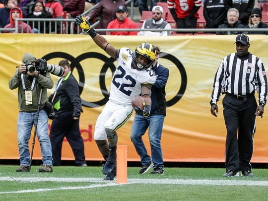 Michigan Wolverines running back Karan Higdon tries to score a touchdown but is out of bounds during the second half against South Carolina in the Outback Bowl at Raymond James Stadium in Tampa, Fla., Monday, Jan. 1, 2018.