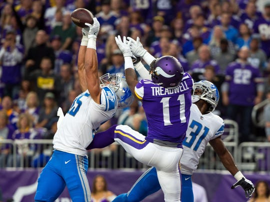 Lions safety Miles Killebrew (35) breaks up a pass to Vikings receiver Laquon Treadwell in the second quarter last season's game in Minnesapolis. The Lions won, 14-7.